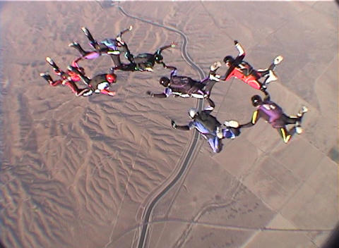 Eight skydivers perform group maneuvers while free-falling Stock Video Footage
