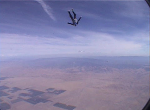 A skydiver jumps from an airplane and free-falls with... Stock Video Footage