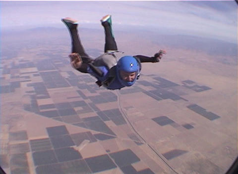 A skydiver jumps from an airplane and free-falls with another skydiver Footage