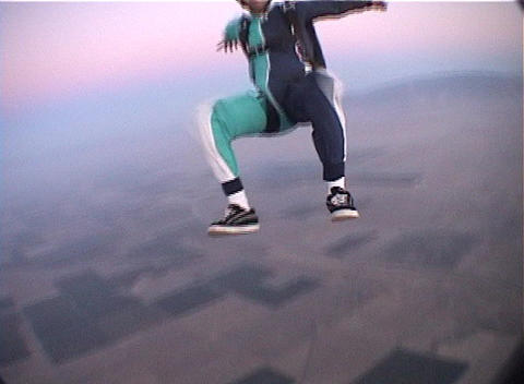 A skydiver free-falls and performs maneuvers Footage