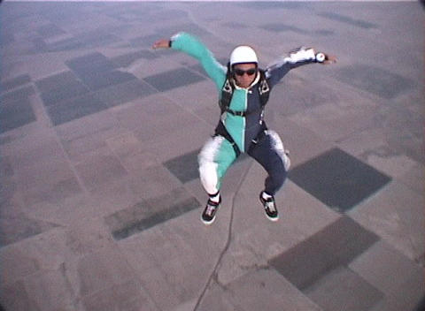 A skydiver free-falls and performs maneuvers Stock Video Footage