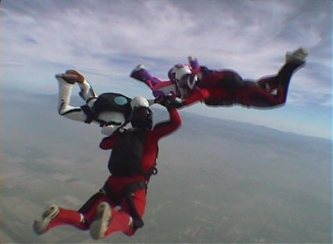Four skydivers jump from an airplane and perform group... Stock Video Footage