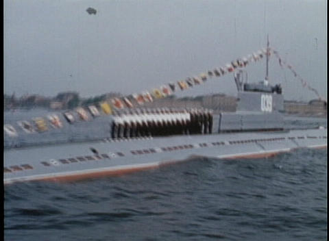 Russian Navy sailors stand on a submarine and salute at a... Stock Video Footage