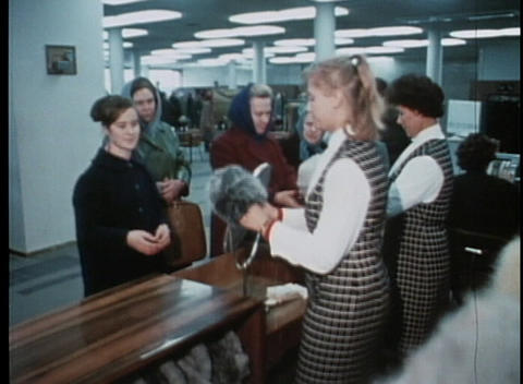 Women buy hats at a department store in this archival shot Stock Video Footage