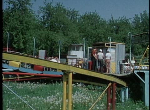 An out of date roller coaster in an amusement park Stock Video Footage