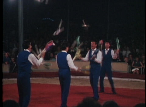 Jugglers perform at a circus in this archival shot Footage