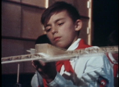 A boy makes a wooden model plane and a teacher... Stock Video Footage