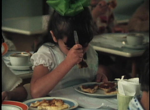 Girls learn to cook in a home economics class in this... Stock Video Footage