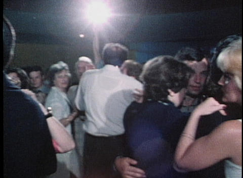 Couples dance in a lounge in this dated shot Footage