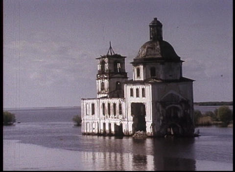 An old color travelogue shot of the Volga River and an abandoned church on an island Footage