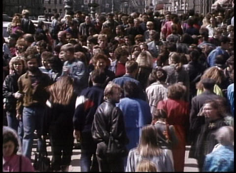 Crowds mill on the streets of the old Soviet Union in... Stock Video Footage