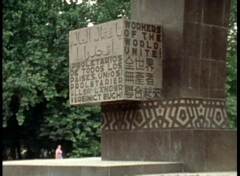 A revolutionary Communist slogan board announces workers of the world unite Footage