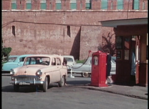 A woman fills on old Lada car at a gas station in the... Stock Video Footage