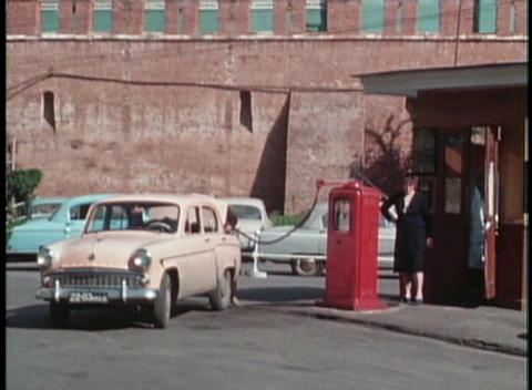 A woman fills on old Lada car at a gas station in the former Soviet Union Footage