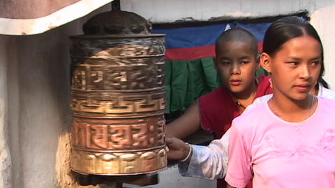 Nepalese Buddhists spinning Buddhist prayer wheel in... Stock Video Footage