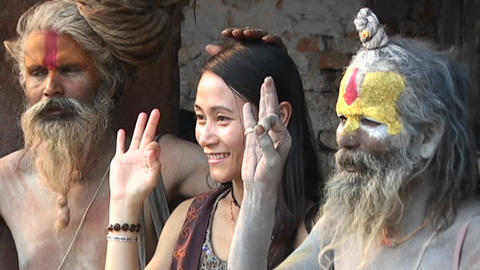 Hindu Sadhus - (Holy men) posing with tourist at Pashupati Temple in Kathmandu Footage