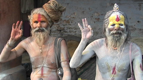 Hindu Sadhus - (Holy men) posing with religious hand gestures at Pashupati Temple in Kathmandu Footage