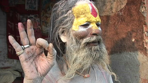 Hindu Sadhu - (Holy man) posing with religious hand gesture at Pashupati Temple in Kathmandu Footage