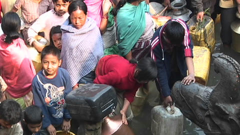 Large group of Nepalese waiting to get drinking water in Kathmandu Footage