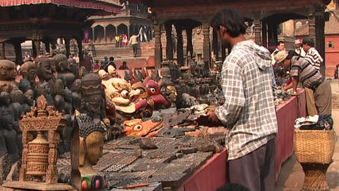Street merchants selling religious items in Patan, Nepal Stock Video Footage