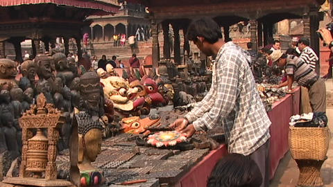 Street merchants selling religious items in Patan, Nepal Footage