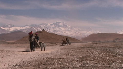 Tibetan man riding in carriage pulled by horse across the... Stock Video Footage