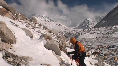Climber climbing above Everest base camp Stock Video Footage