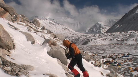 Climber climbing above Everest base camp Stock Video Footage