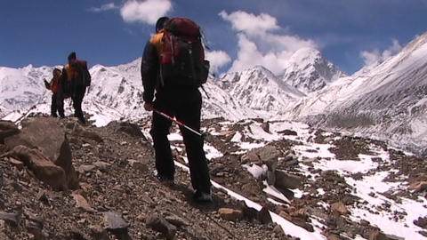 Climbers walk into panoramic Himalayan background Footage