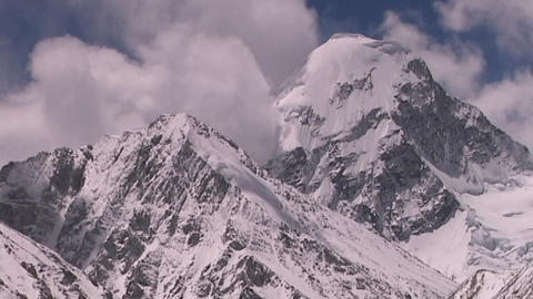 Shot from Everest in Tibet, clouds surrounding Mt. Pumori... Stock Video Footage
