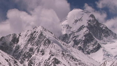 Shot from Everest in Tibet, clouds surrounding Mt. Pumori in Nepal Footage