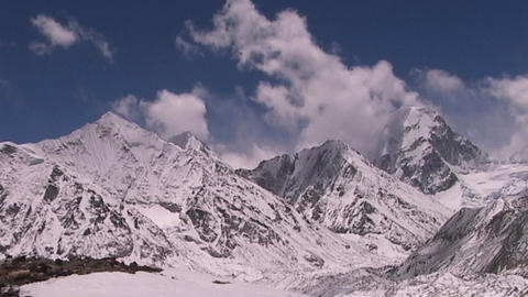 Shot from Mt. Everest in Tibet, clouds blanketing Mt. Pumori in Nepal Footage