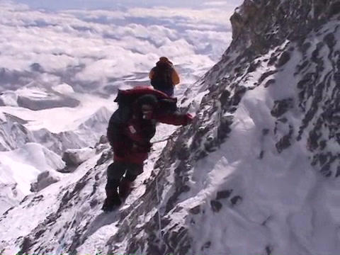 In The Death Zone Near The Summit Of Everest - Climber Navigates Scary Terrain stock footage