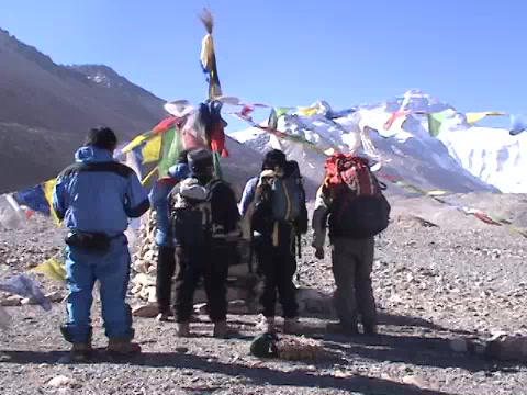 Climbers praying / honoring Mt. Everest in Tibet Stock Video Footage