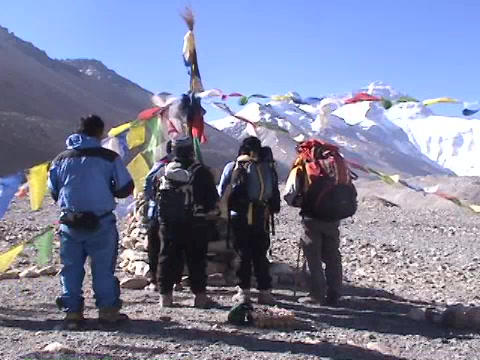 Climbers praying / honoring Mt. Everest in Tibet Footage