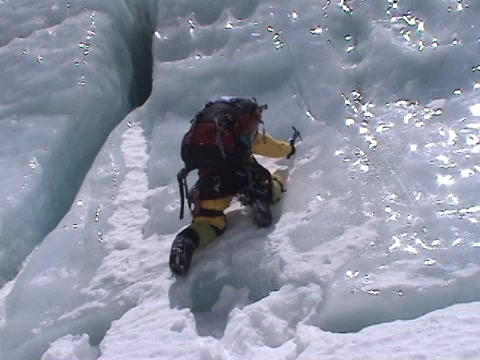 Extreme ice climbing - climbing up an icefall Footage