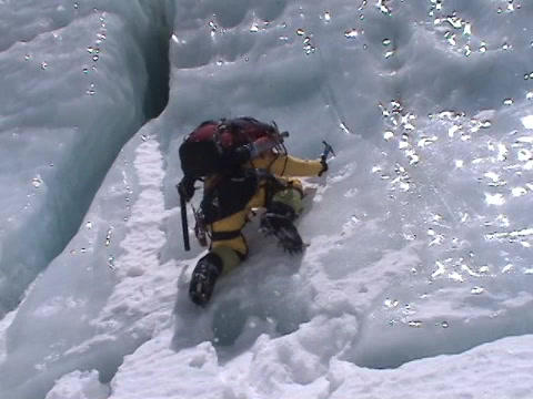 Extreme ice climbing - climbing up an icefall Stock Video Footage