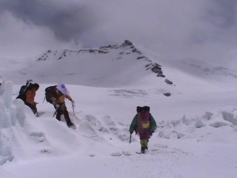 A team of climbers crosses snow and ice on Mt.  Everest Stock Video Footage