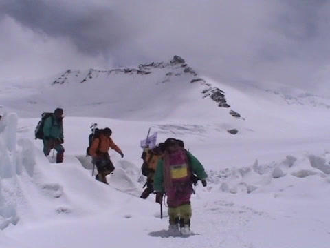 A team of climbers crosses snow and ice on Mt.  Everest Footage