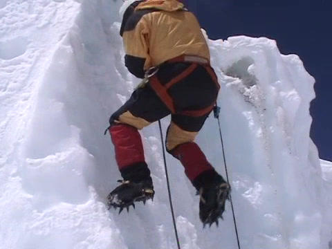 Extreme ice climbing - climbing down an icefall Footage