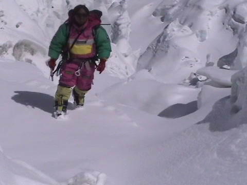 Climber climbs up on a snow and ice field Footage