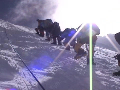 A team of climbers ascends an icy slope on Mt.  Everest Stock Video Footage