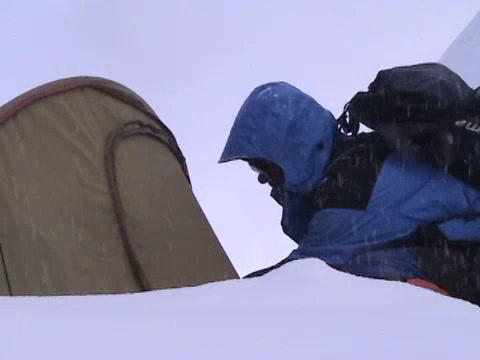 A climber opens up his tent high on Everest Footage