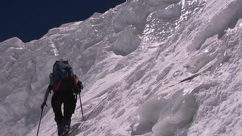 Climber ascends the vertical, icy slopes of Mt. Everest Stock Video Footage
