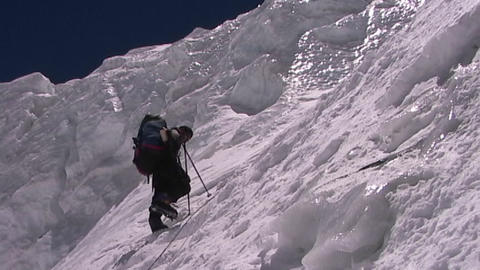 Climber ascends the vertical, icy slopes of Mt. Everest Footage