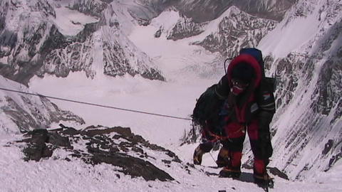 In the death zone climbing towards the summit of Everest - Climbers navigate difficult terrain Footage