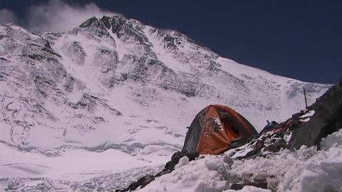 An expedition tent with Mt. Everest pinnacles and the summit in the background Footage