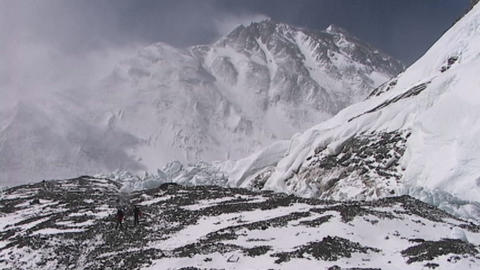 Climbers walking in the distance with Mt. Everest... Stock Video Footage