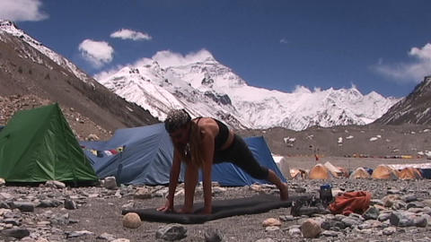 Attractive woman does yoga at Mt. Everest base camp -... Stock Video Footage