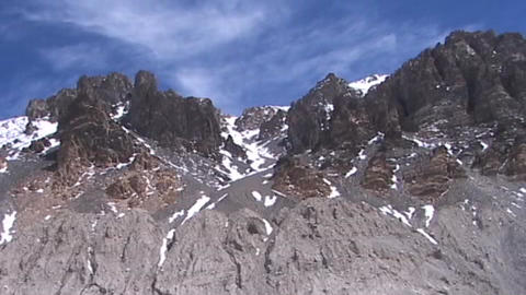Time lapse of clouds moving across a summit ridge near... Stock Video Footage